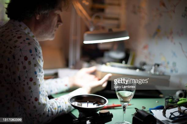 senior man repairing an old turn table at home - north holland stock pictures, royalty-free photos & images