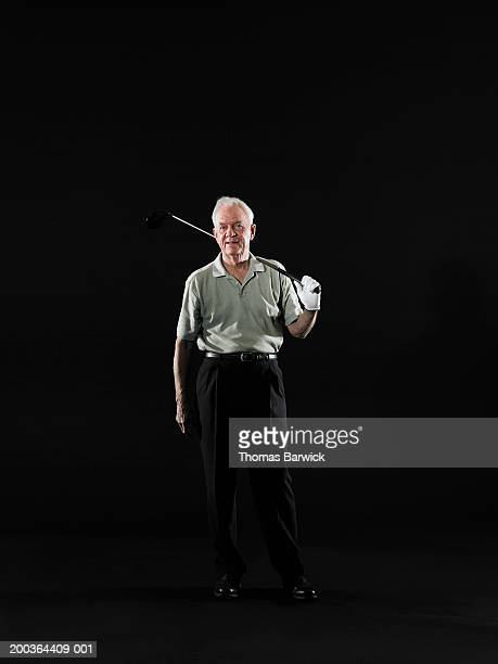 senior man resting golf club on shoulder, portrait - open collar stock photos and pictures