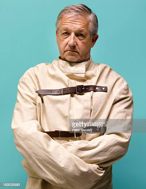 senior man restrained in a straight jacket - straight jacket stock pictures, royalty-free photos & images