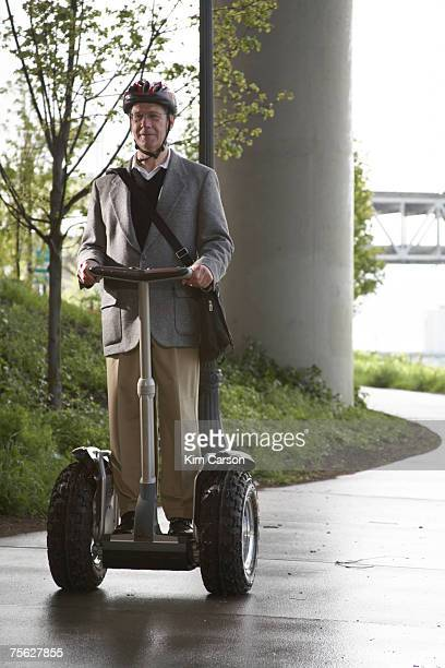 Senior man riding segway
