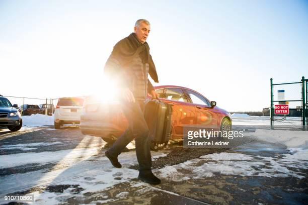 Senior man running in snow