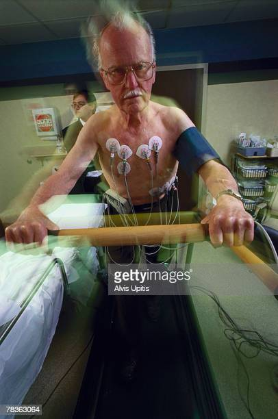senior man running on treadmill in examination with doctor - stress test stock pictures, royalty-free photos & images