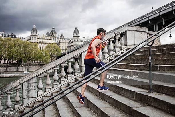 Senior man running steps in Paris