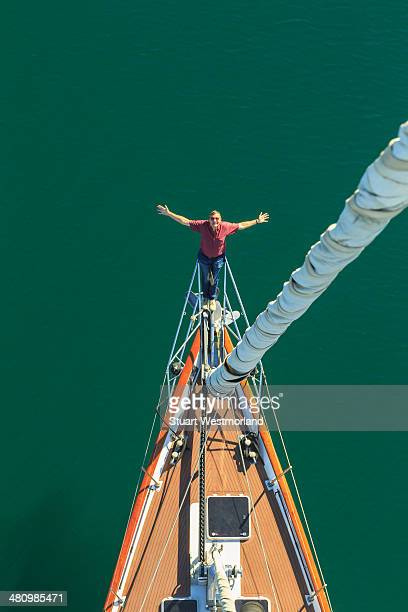 senior man seen sailing from above with arms outstretched, san diego, california, usa - exhilaration stock photos and pictures