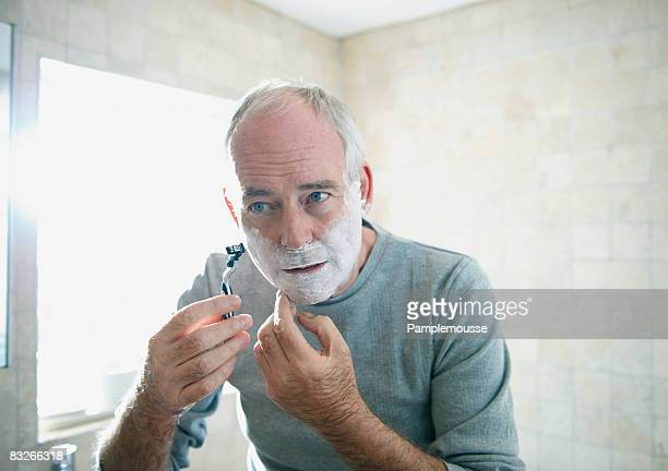 Senior man shaving