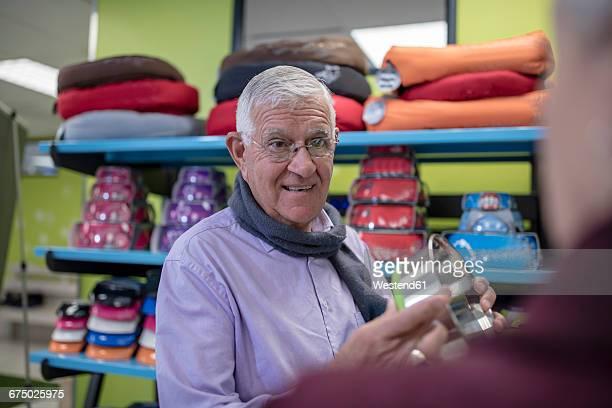 Senior man shopping in a pet shop