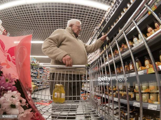 senior man shopping in the supermarket - camera point of view stock photos and pictures
