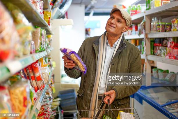 a senior man shopping. - convenience store stock photos and pictures