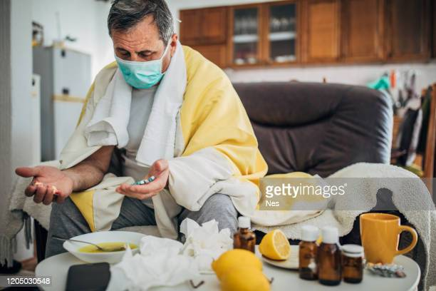 senior man sick with corona virus - quarantine stock pictures, royalty-free photos & images