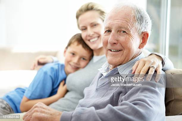 Senior man sitting with his daughter and grandson