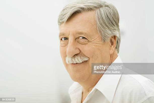 Senior man smiling at camera, portrait
