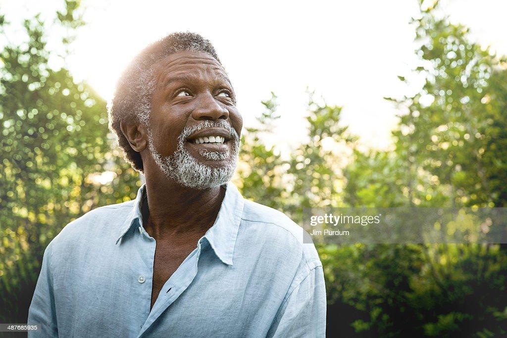 Senior man smiling outdoors : Stock Photo