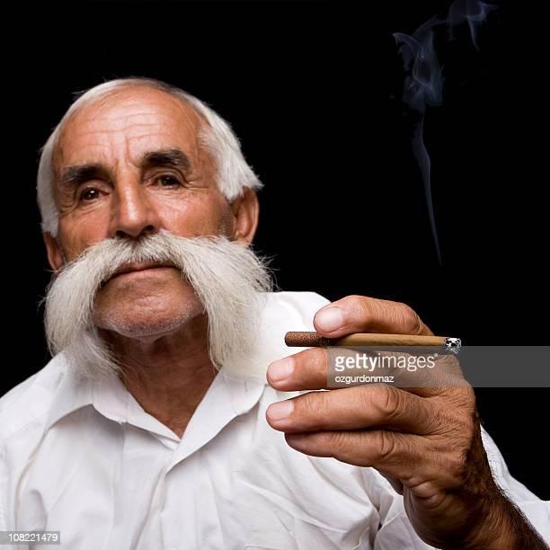 Senior Man Smoking Cigar