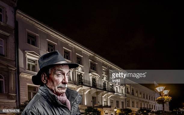 Senior man spy concept in city at night