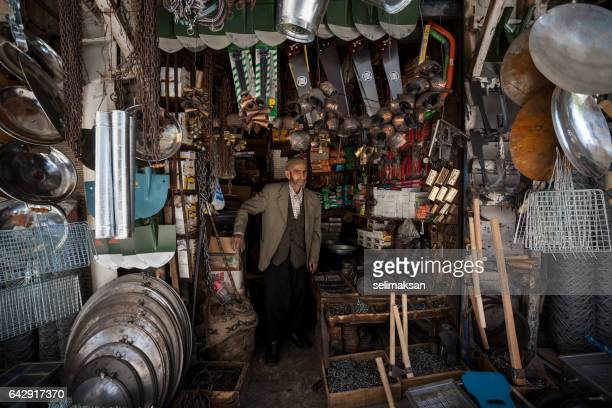 Senior Man Standing In Front Of his Hardware Store