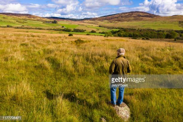senior man standing in the countryside of dumfries and galloway - johnfscott stock pictures, royalty-free photos & images