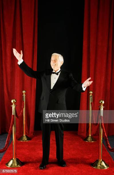 Senior man standing on the red carpet