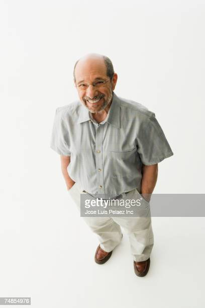 Senior man standing with hand in pockets