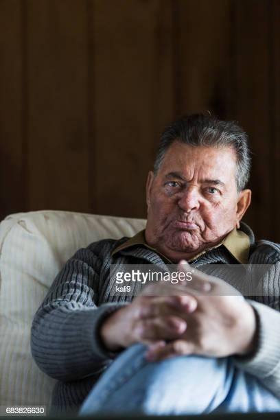 Senior man staring at camera