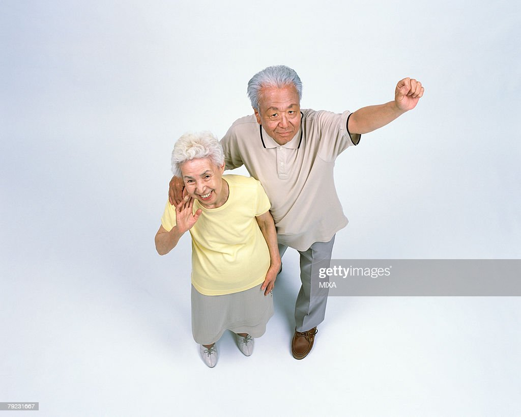 A senior man stretching arms : Stock Photo