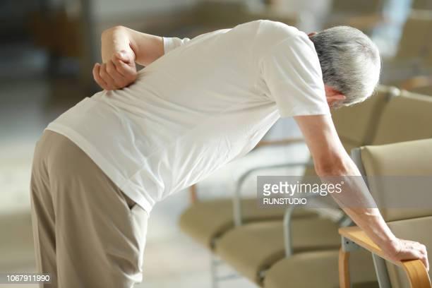 senior man suffering from backache - 背痛 ストックフォトと画像