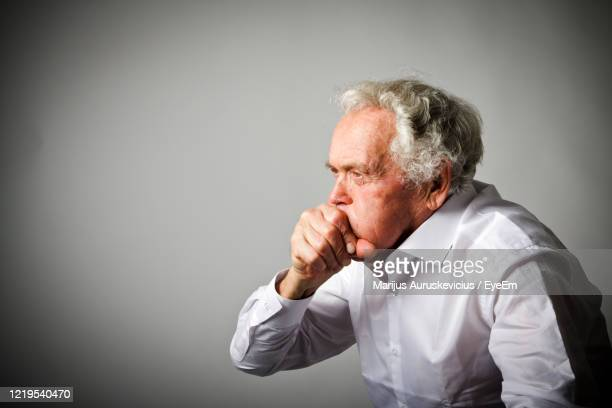 senior man suffering from cough - coughing stock pictures, royalty-free photos & images