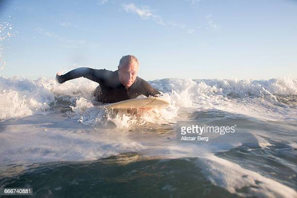 Senior man surfing