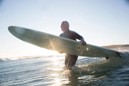 Senior man surfing - gettyimageskorea