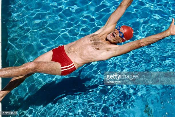 Senior man swimming in the pool