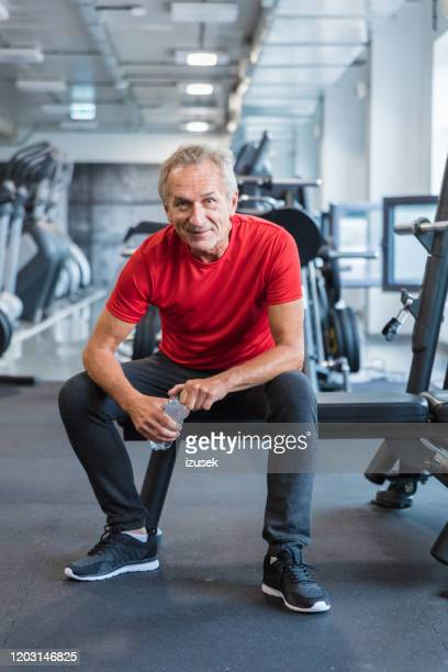 senior man taking a break at rehabilitation in gym - patient stock pictures, royalty-free photos & images