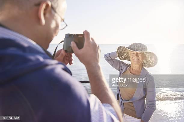 Senior man taking photos of his wife. Gdansk, Poland