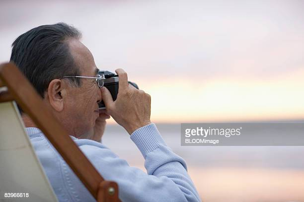 Senior man taking picture