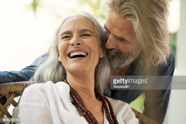 senior man taking selfie at poolside while his wife is playing the guitar - young at heart stock pictures, royalty-free photos & images
