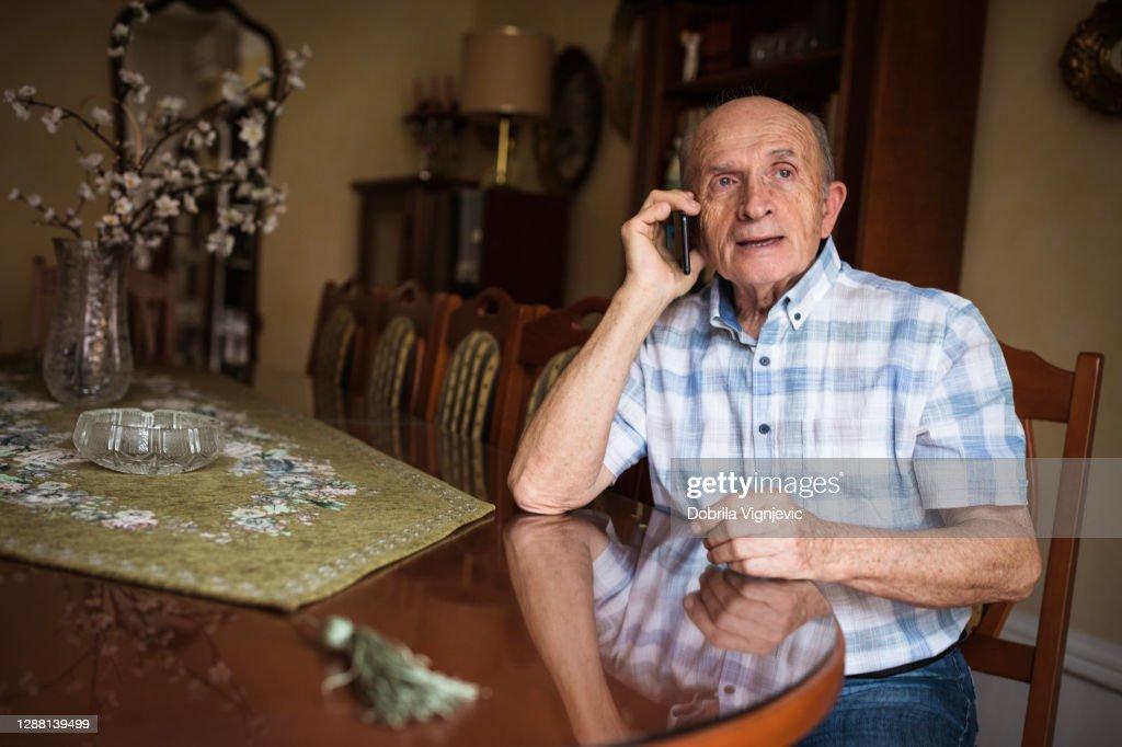 Senior man talking on phone : Stock Photo
