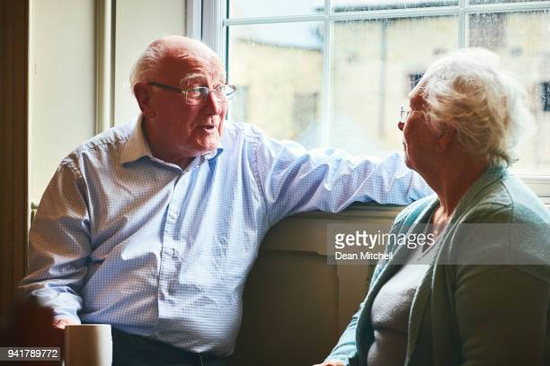 Senior man talking with his wife at home