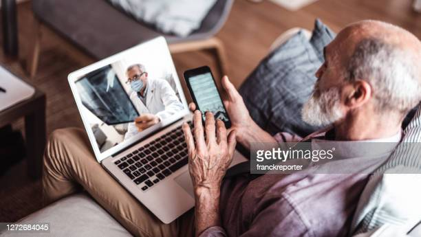senior man teleconsulting with the doctor - advice stock pictures, royalty-free photos & images