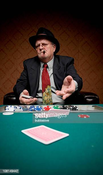 senior man throwing down his cards at poker table - gambling table stock pictures, royalty-free photos & images