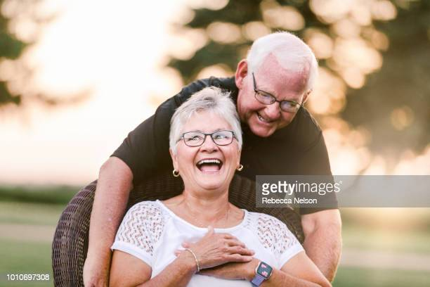 senior man tickling senior woman - naughty wife stock photos and pictures
