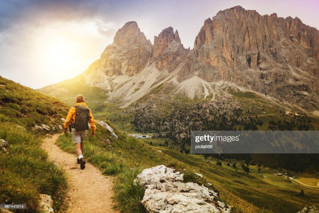 Senior man trail hiking on high mountain : Stock Photo