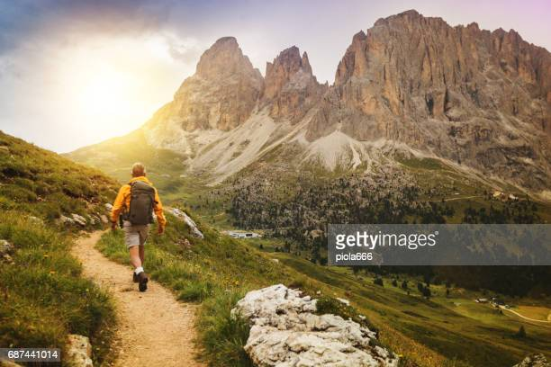 senior man trail hiking on high mountain - outdoor pursuit stock pictures, royalty-free photos & images