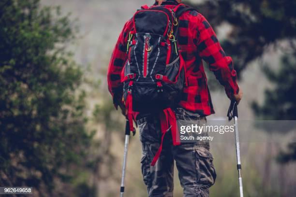 Senior man trail hiking on mountain