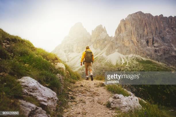 Senior man trail hiking on the Dolomites