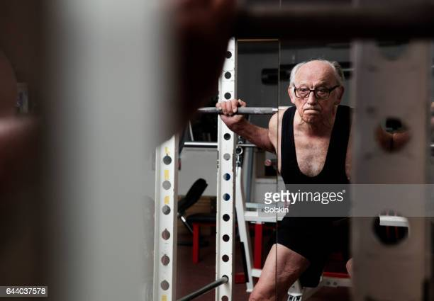 senior man training in gym - tank top stock pictures, royalty-free photos & images