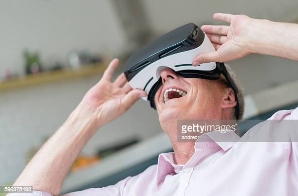 Senior man trying a VR device