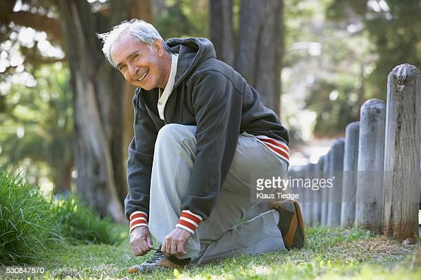 Senior man tying his shoe
