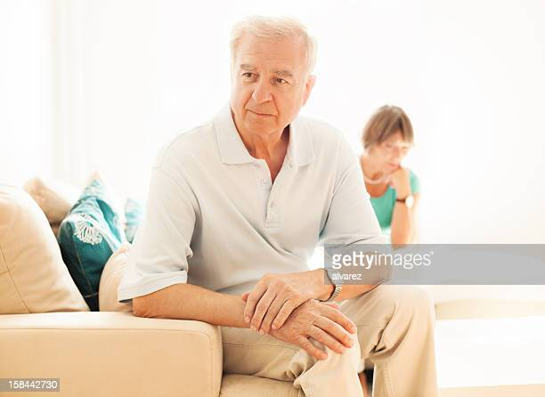 Senior man upset while wife watches