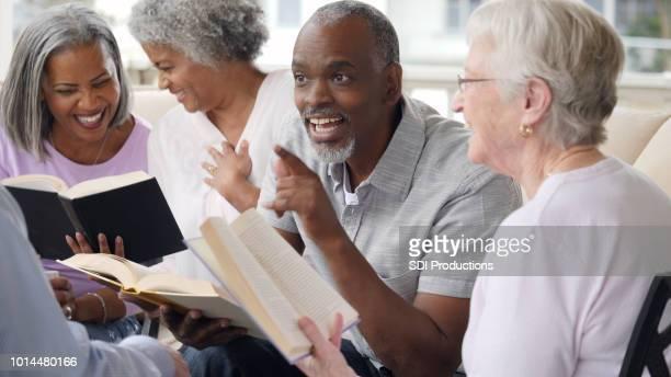 Senior man uses humor during outdoor Bible study
