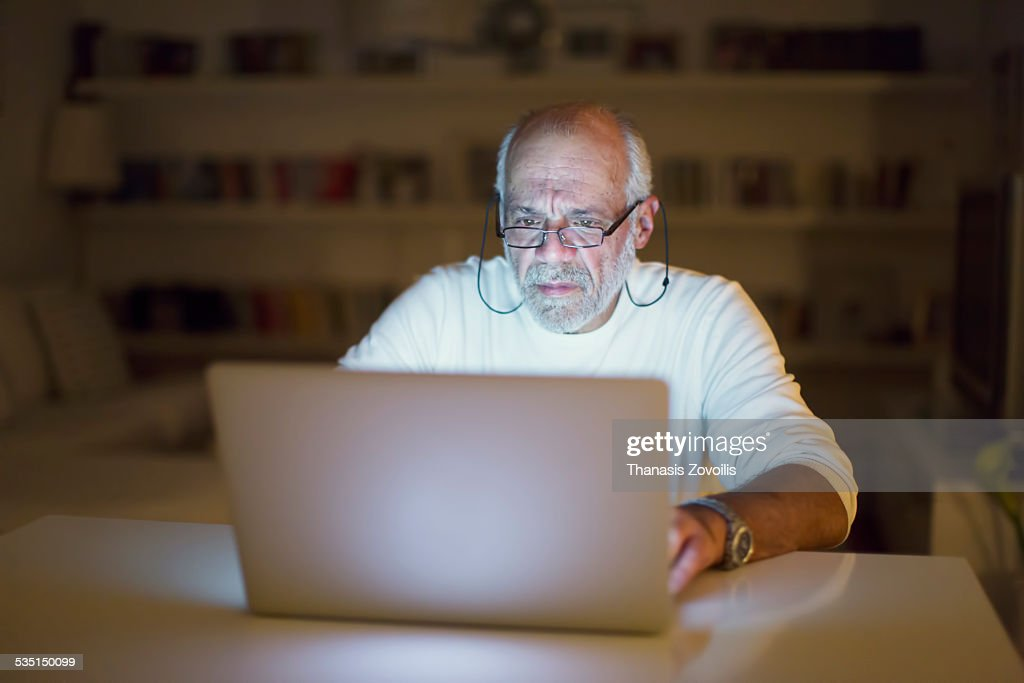 Senior man using a laptop : Stock Photo