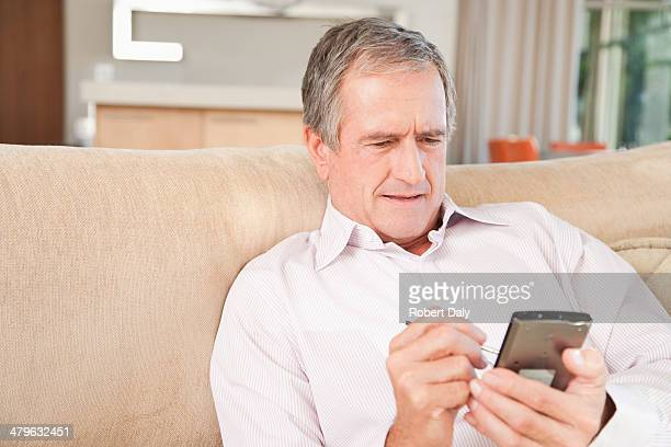 senior man using a personal digital assistant