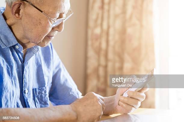 Senior Man Using a Smartphone